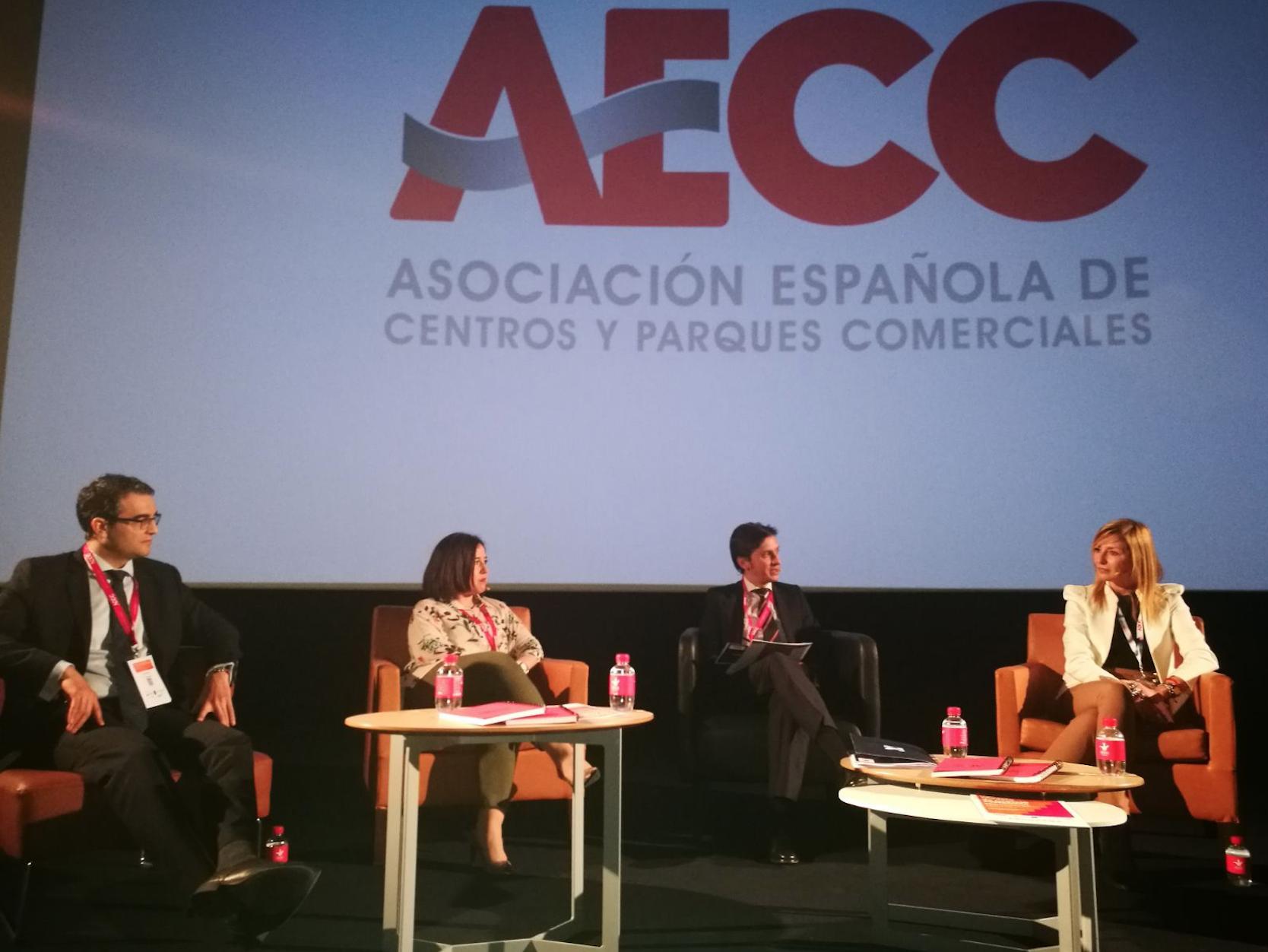Aparece una mesa de discusión de un evento de AECC